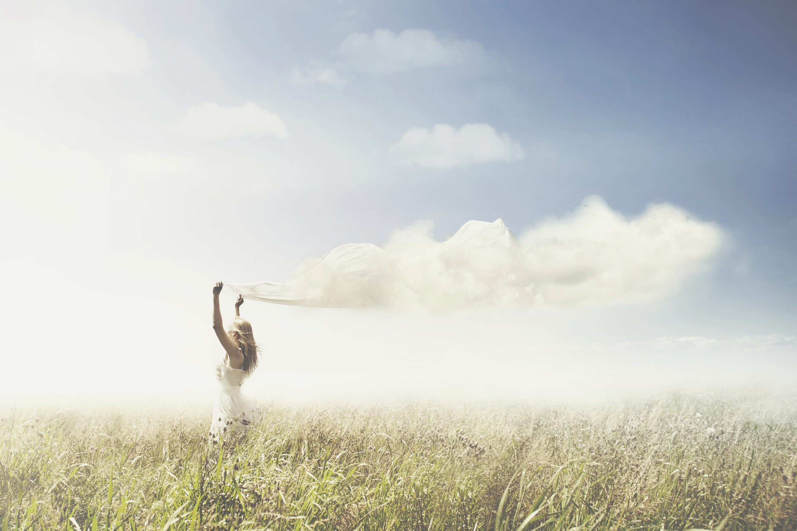 sweet dream of a girl carrying a cloud in the sky
