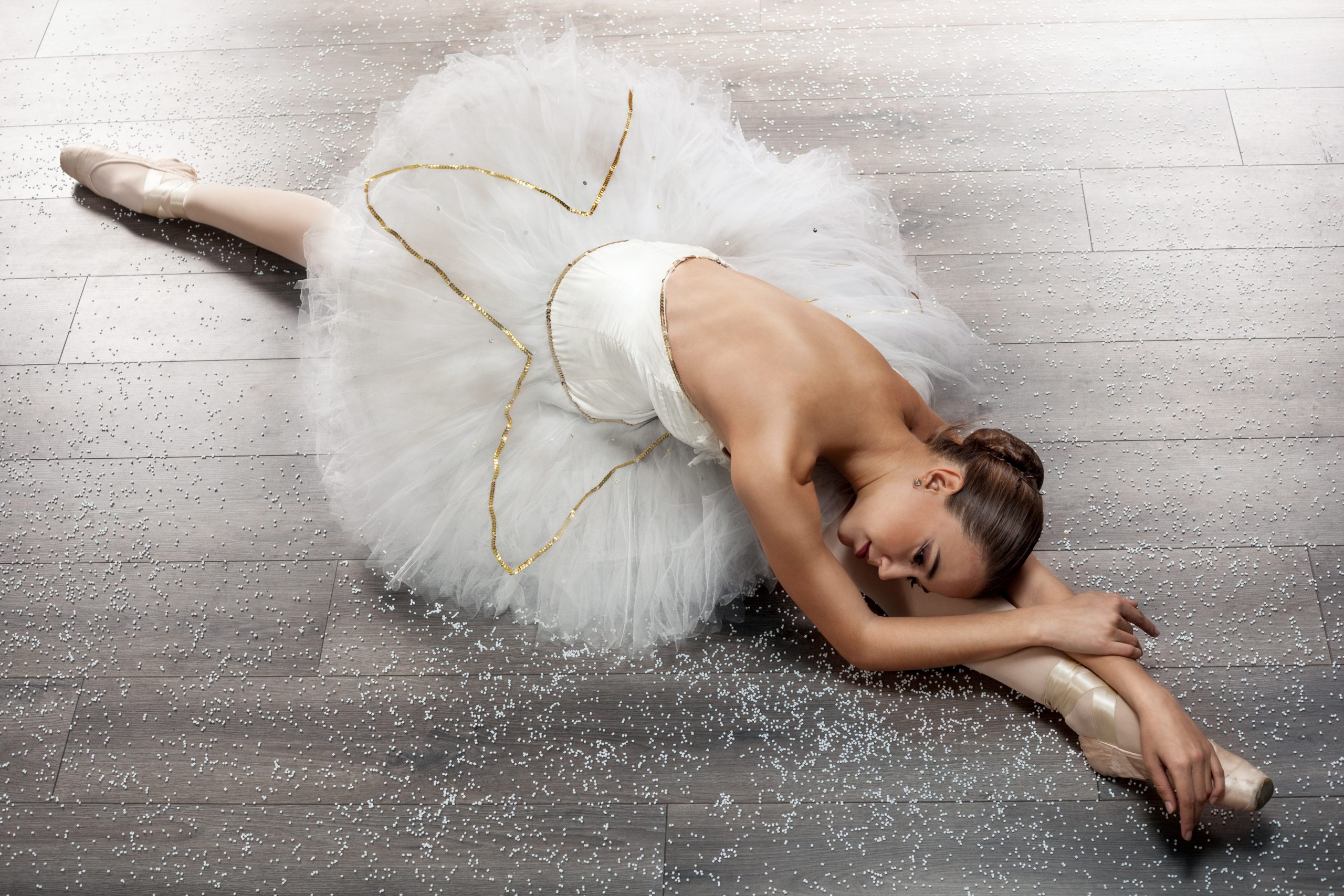 Ballerina is wearing a white tutu and pointe shoes